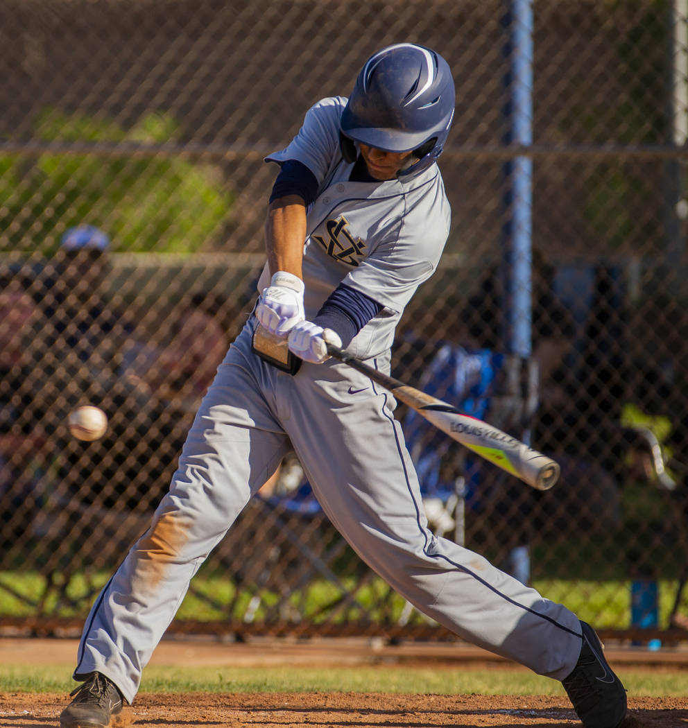 Spring Valley's Chase Rodriguez (22) readies to connect on a pitch versus Liberty duri ...