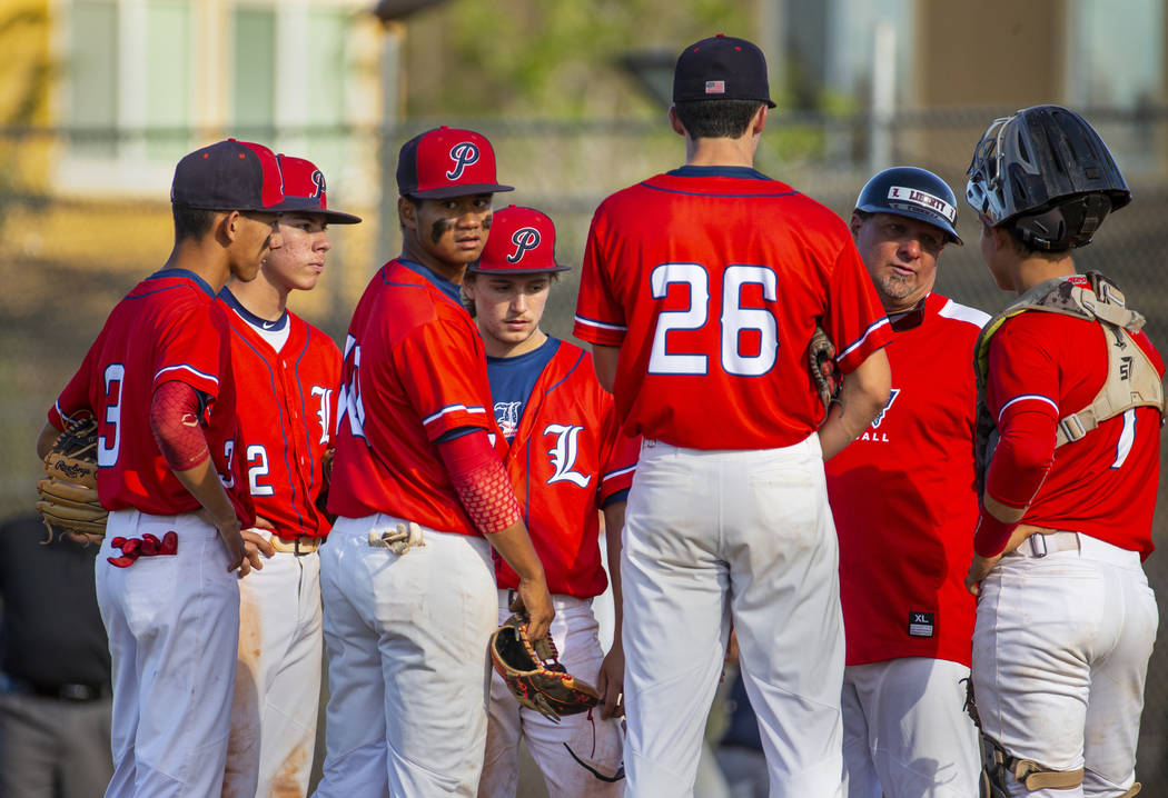 Liberty players come together with head coach Rich Ebarb for a time out versus Spring Valley ...