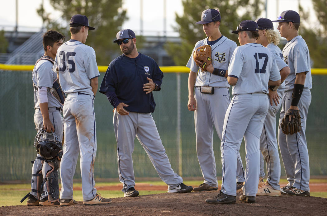 Spring Valley head coach Paul Bassett meets with his players during a time out versus Libert ...
