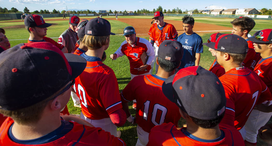 Liberty head coach Rich Ebarb motivates his players late in the game during a time out versu ...