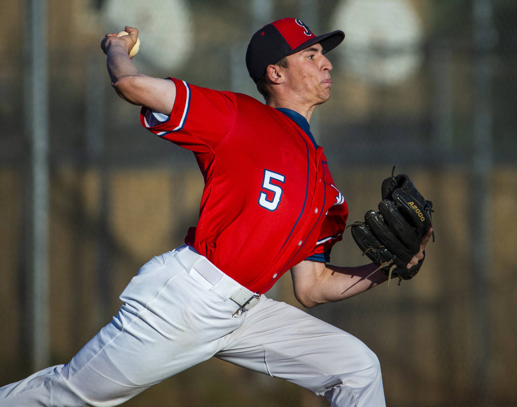 Liberty' pitcher Garrett Maloney (5) finishes off Spring Valley during the first round ...