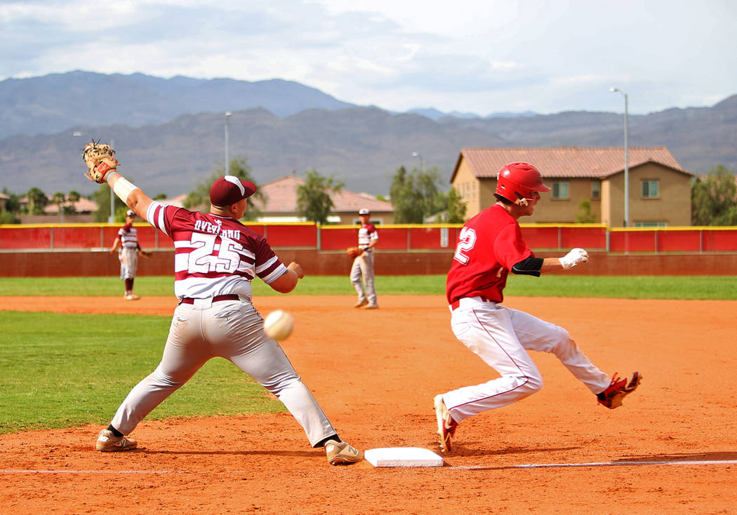 Arbor View's (12) makes it safe to first as Cimarron-Memorial's Mike Overland (2 ...