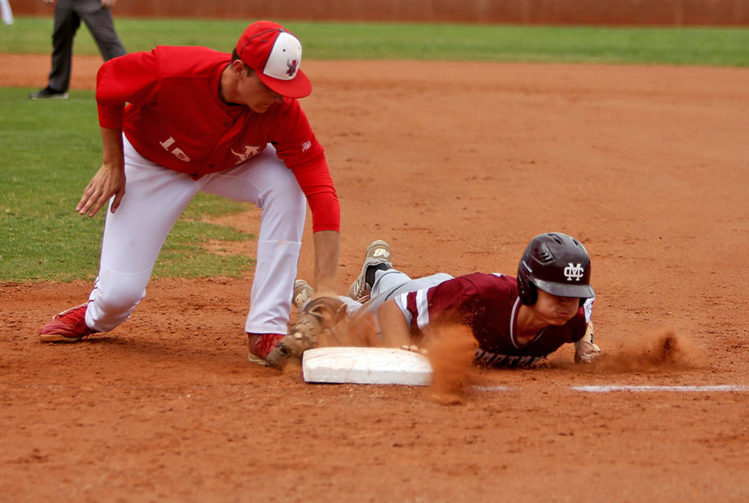 Arbor View's Jacob Scioli (16) attempts to tag out Cimarron-Memorial's Ethan Dan ...