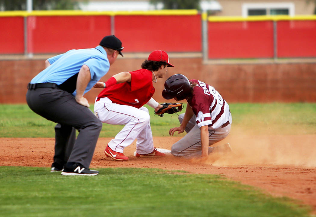 Arbor View's Garrett Cutting (7) tags out Cimarron-Memorial's Jackson Folkman (6 ...