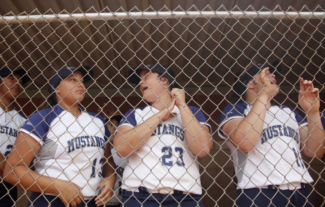 Shadow Ridge High School players Mikayla Brown (13), Alexis Toia (23), and Tori Nichols (16) ...