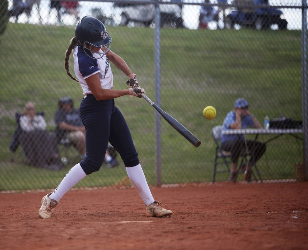 Shadow Ridge High School's Taylor Hendricks (5) bats against Centennial High School in ...