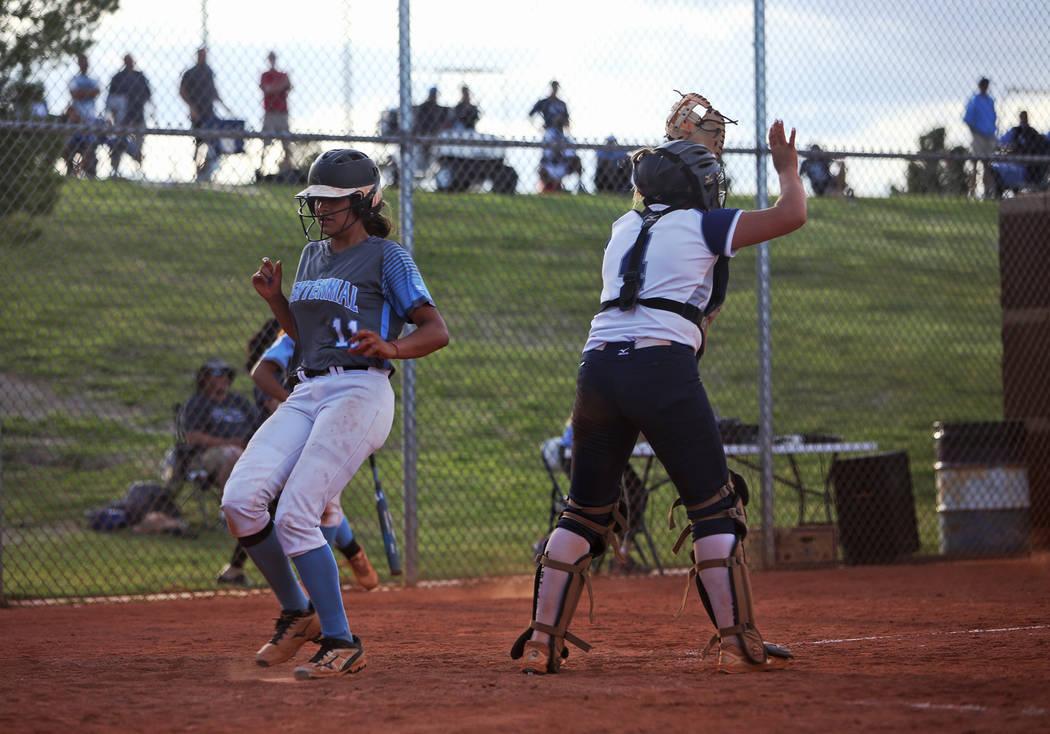 Centennial High School's Jacqueline Perez Mena (11) makes home base against Shadow Rid ...