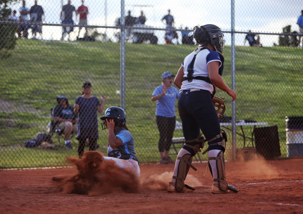 Centennial High School's Natasha Lawrence (3) makes a home run right after another tea ...