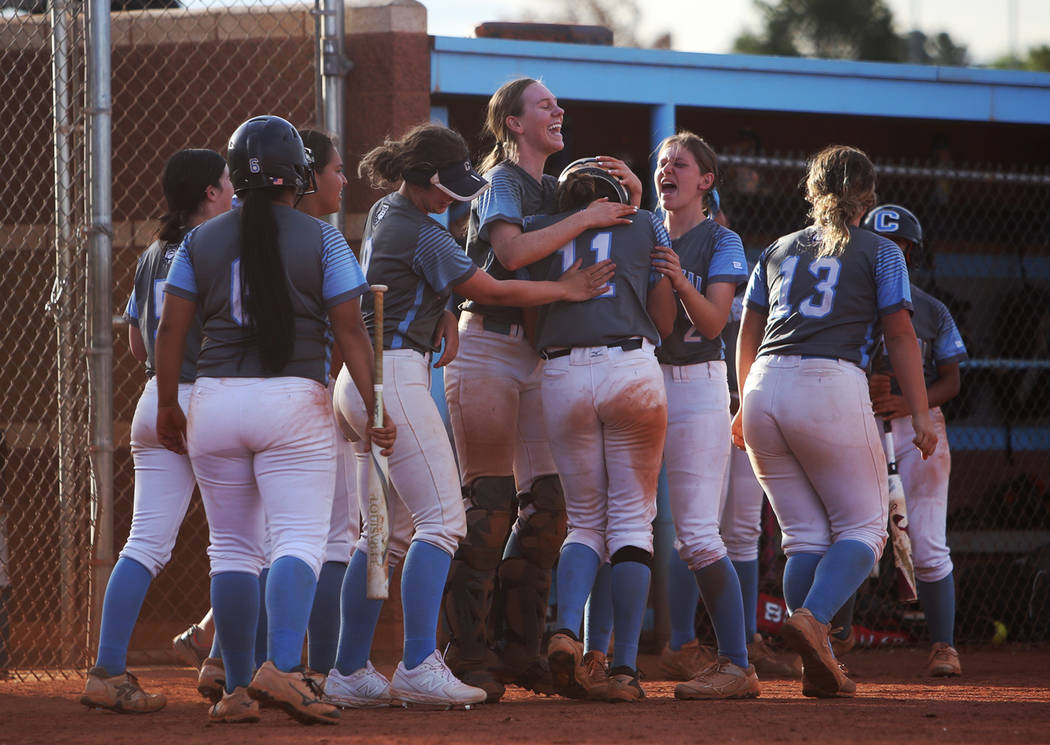Centennial High School's Jacqueline Perez Mena (11) is applauded by teammates after th ...