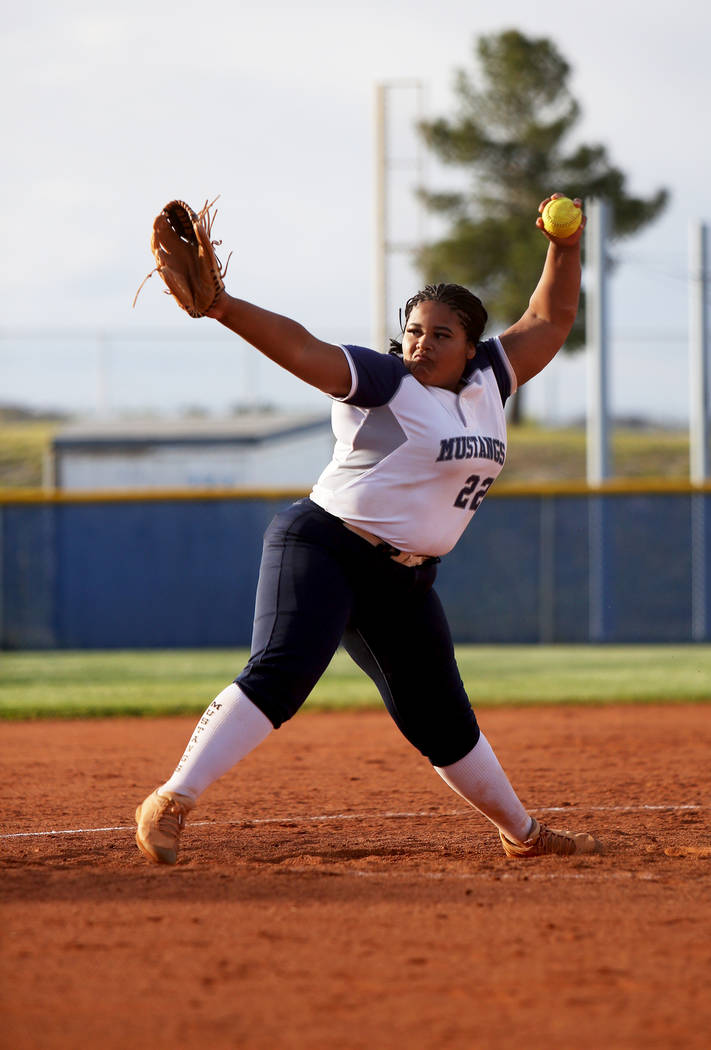 Shadow Ridge High School's Alexia Toia (23) winds the pitch against Centennial High Sc ...