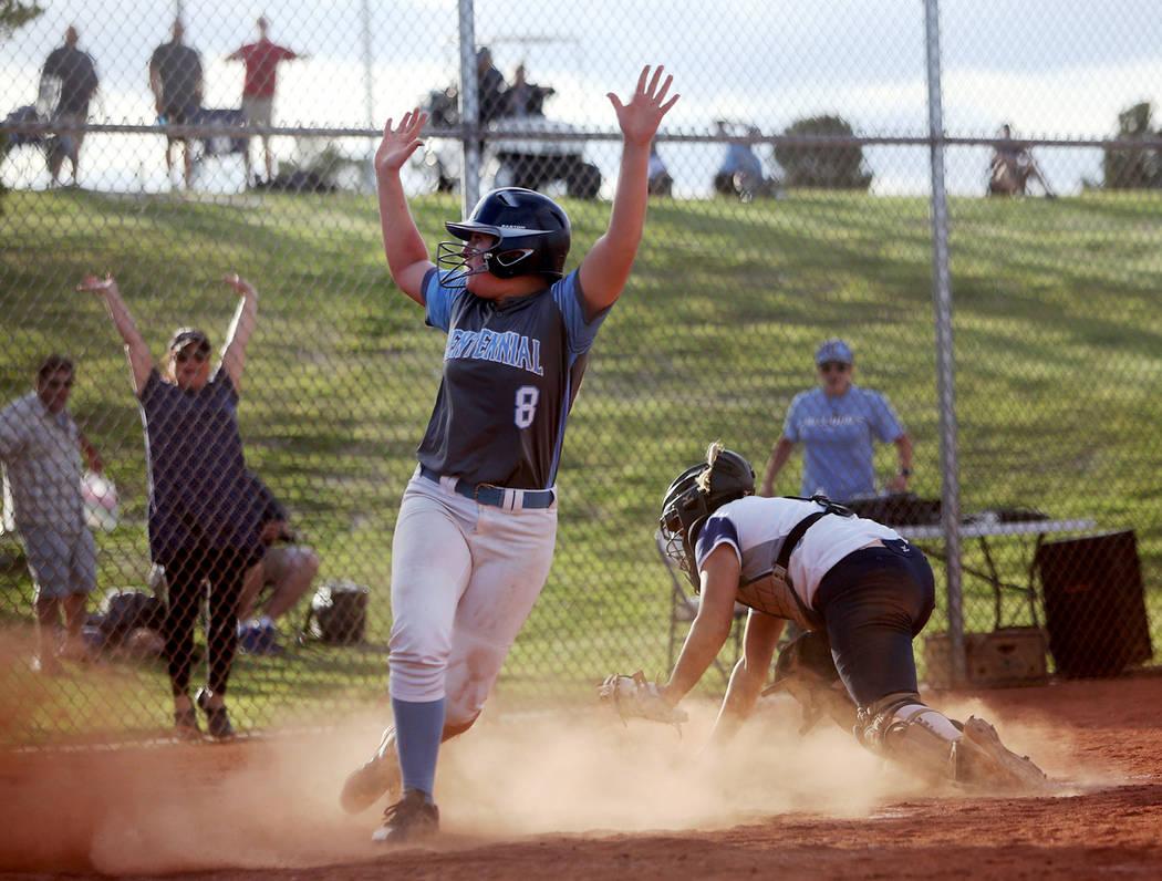 Centennial High School's Ashlynn Heck (8) makes a home run, winning the game 3-2 again ...