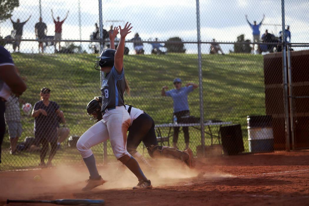 Centennial High School's Ashlynn Heck (8) scores the winning run against Shadow Ridge ...