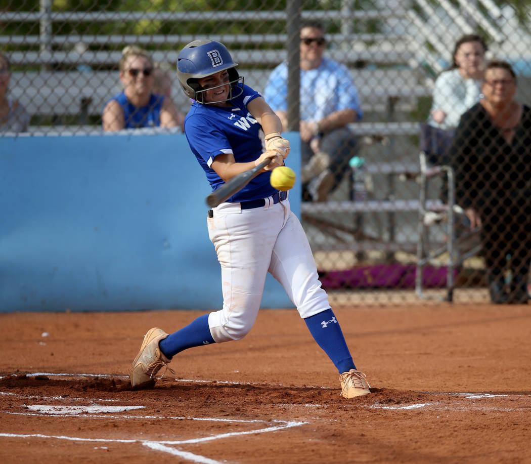 Basic's Mikayla Berg (15) hits a three-run single in the first inning of their Desert ...
