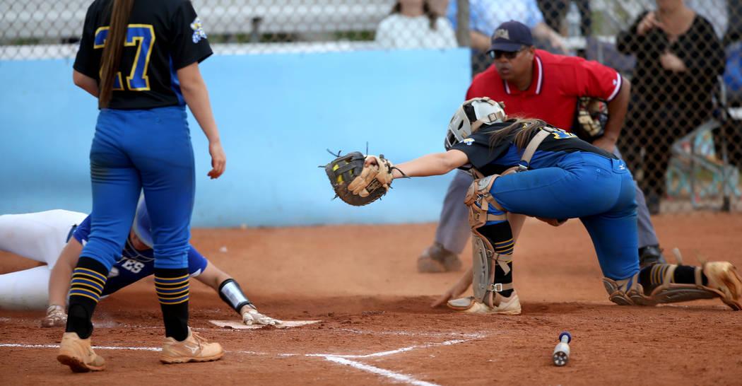 Basic's Jordan Stinett (10) slides across home plate as Sierra Vista catcher Aaliyah ...