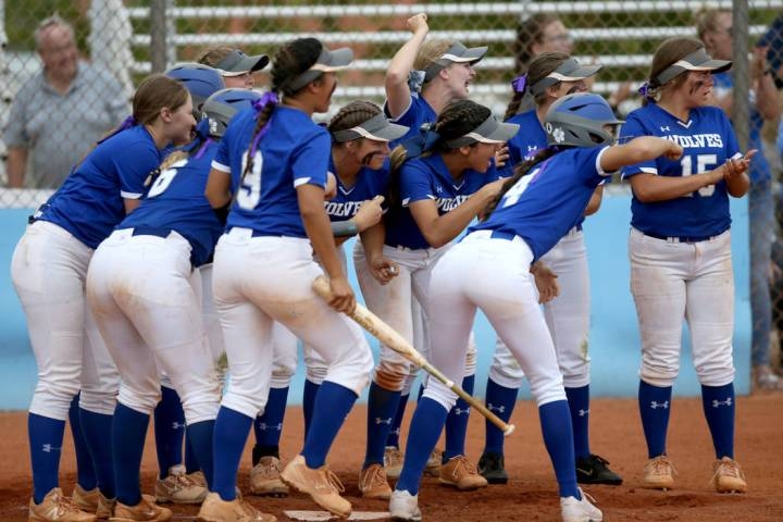 Basic players celebrate a home run by Sierra McClean (12) in the fourth inning of their Dese ...