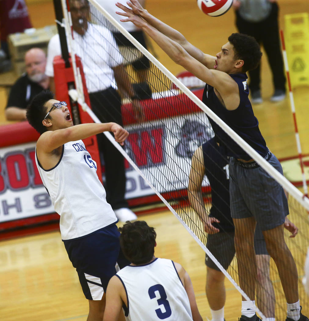 Coronado's Justin Fan (15) gets the ball past Foothill's Jace Roquemore (3) duri ...