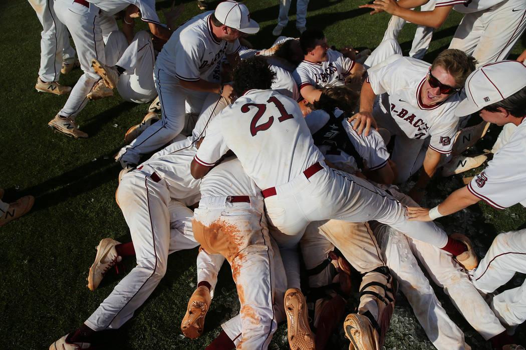 Desert Oasis celebrate their win over Basic in the Desert Region championship baseball game ...