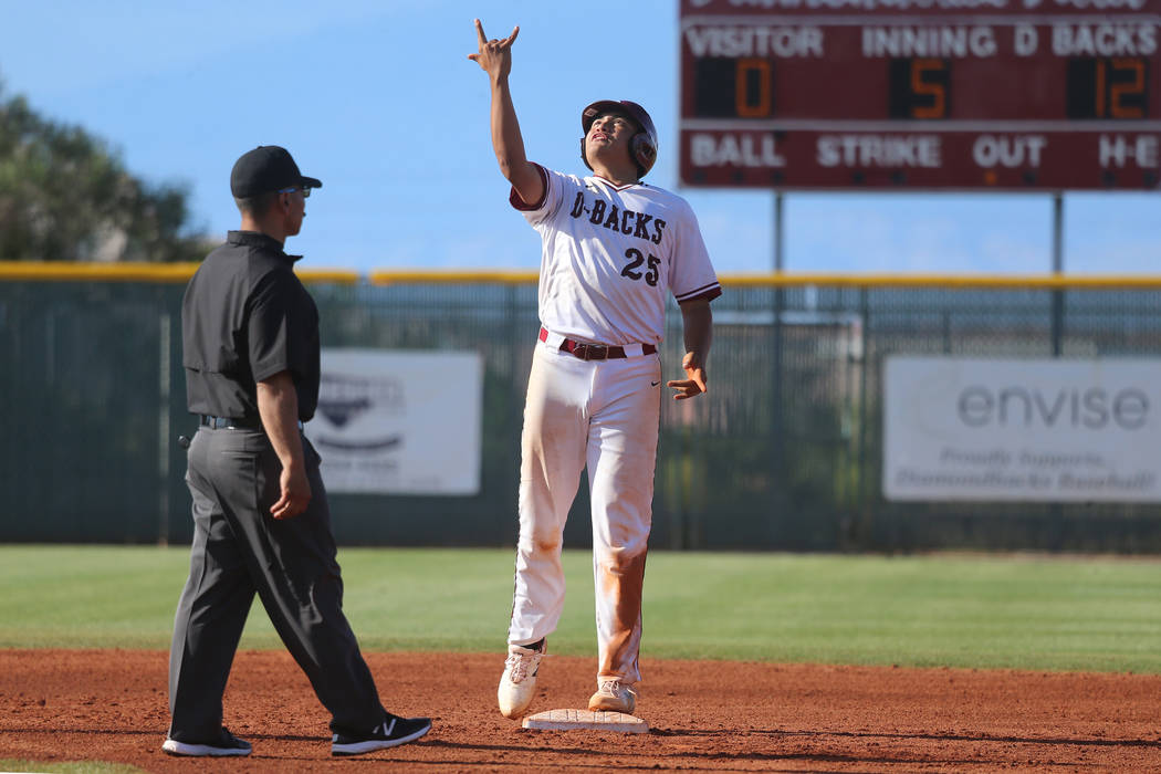 Desert Oasis' Aaron Roberts (25) reacts after hitting a double for a single RBI agains ...