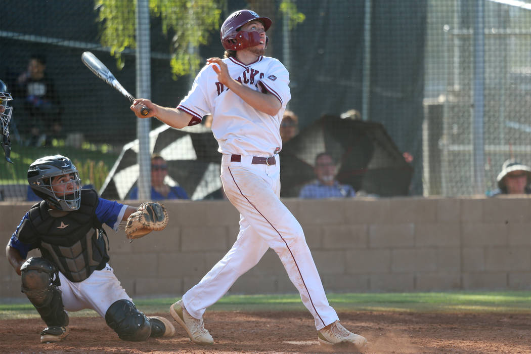 Desert Oasis' Campbell Holt (15) watches the ball leave for a solo homer against Basic ...