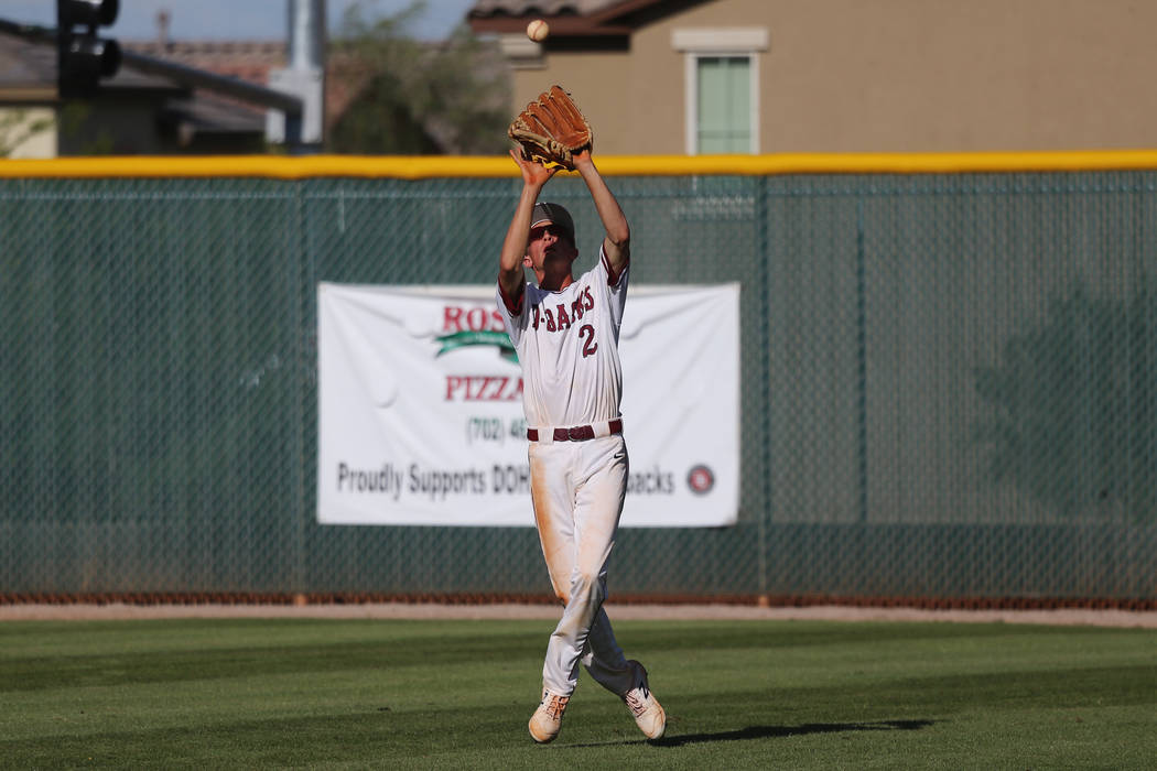 Desert Oasis' Jordan DeMarce (2) makes a catch for an out in the outfield against Basi ...