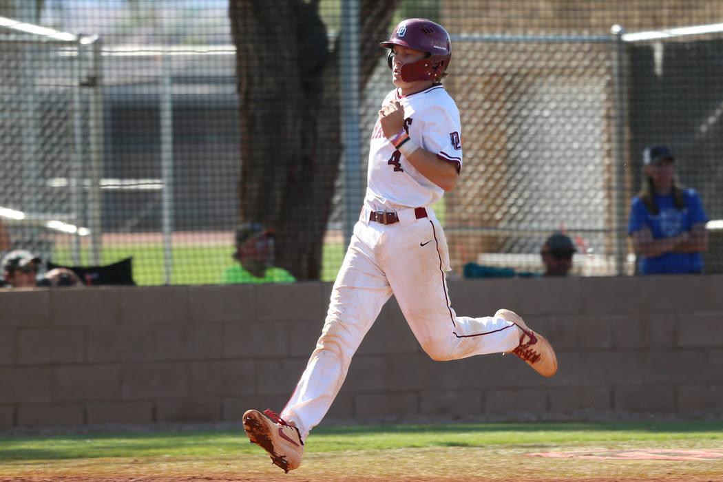 Desert Oasis' Parker Schmidt (4) runs home for a run against Basic in the Desert Regio ...