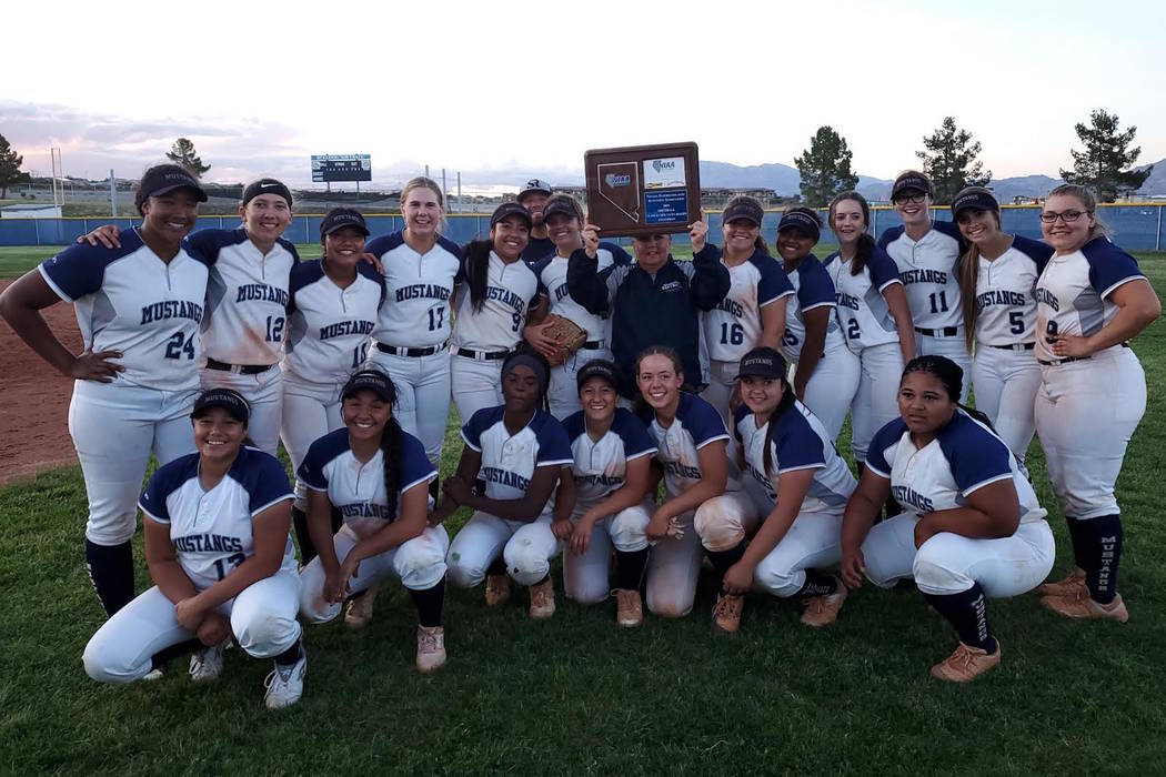 Shadow Ridge poses with the Mountain Region trophy after defeating Centennial, 3-2 in 11 inn ...