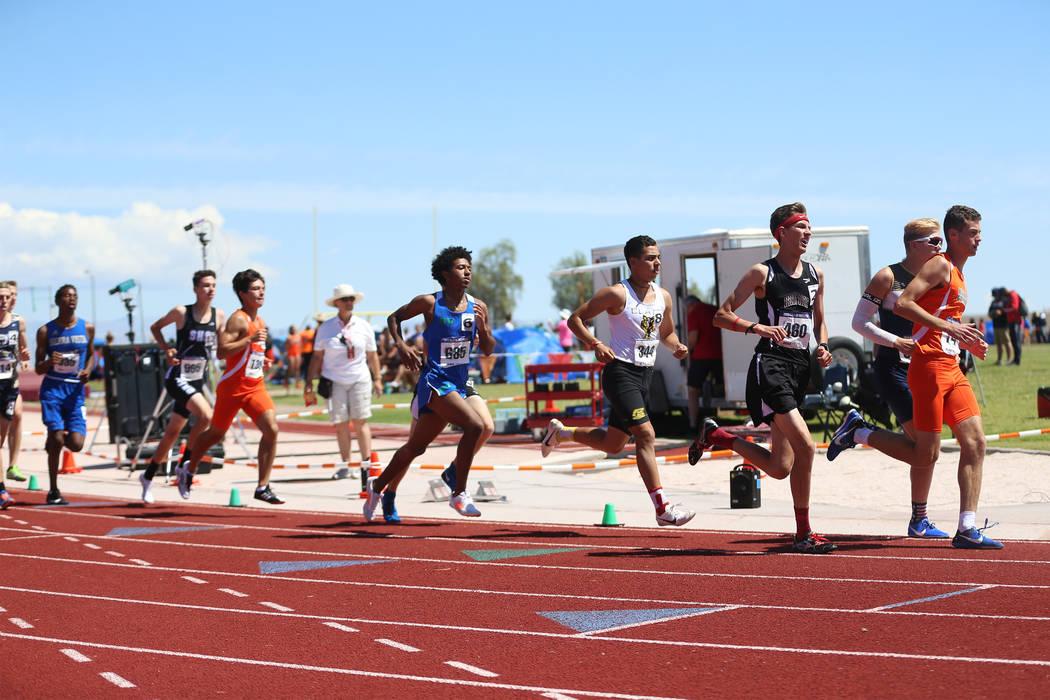 Runners compete in the Desert Region boys 3200 meter run at Desert Oasis High School in Las ...