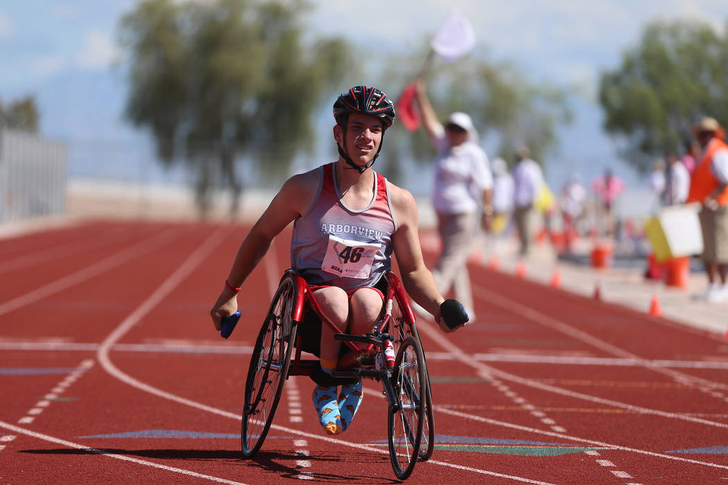 Arbor View's Blake Dickinson (46) competes in the Mountain Region boys 100 meter wheel ...