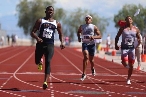 Legacy's Jerry Martin (747), from left, runs for first place, with Canyon Springs Isai ...