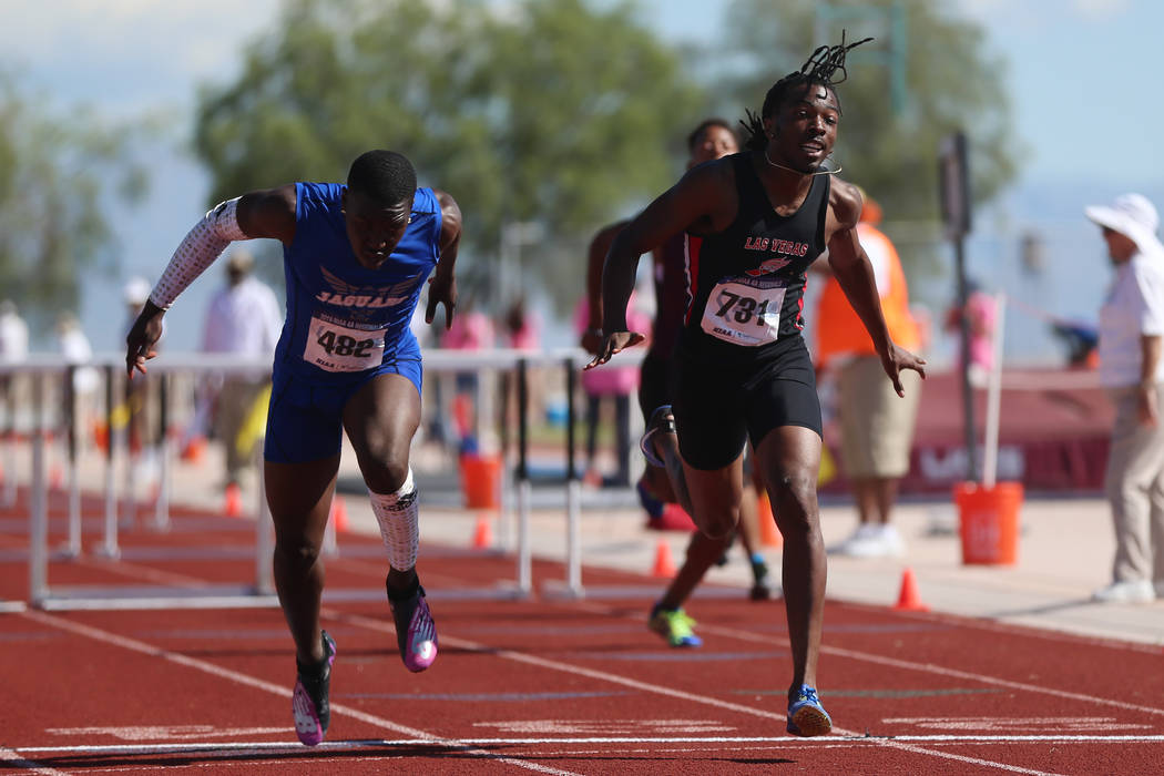 Desert Pines' Jamel Brown (482), left, wins first place in the Mountain Region boys 11 ...