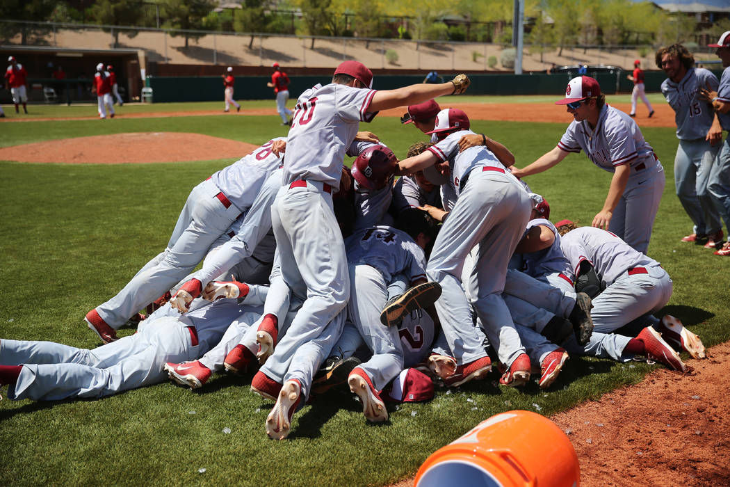 Desert Oasis celebrates their walkout win against Las Vegas in the Southern Nevada champions ...