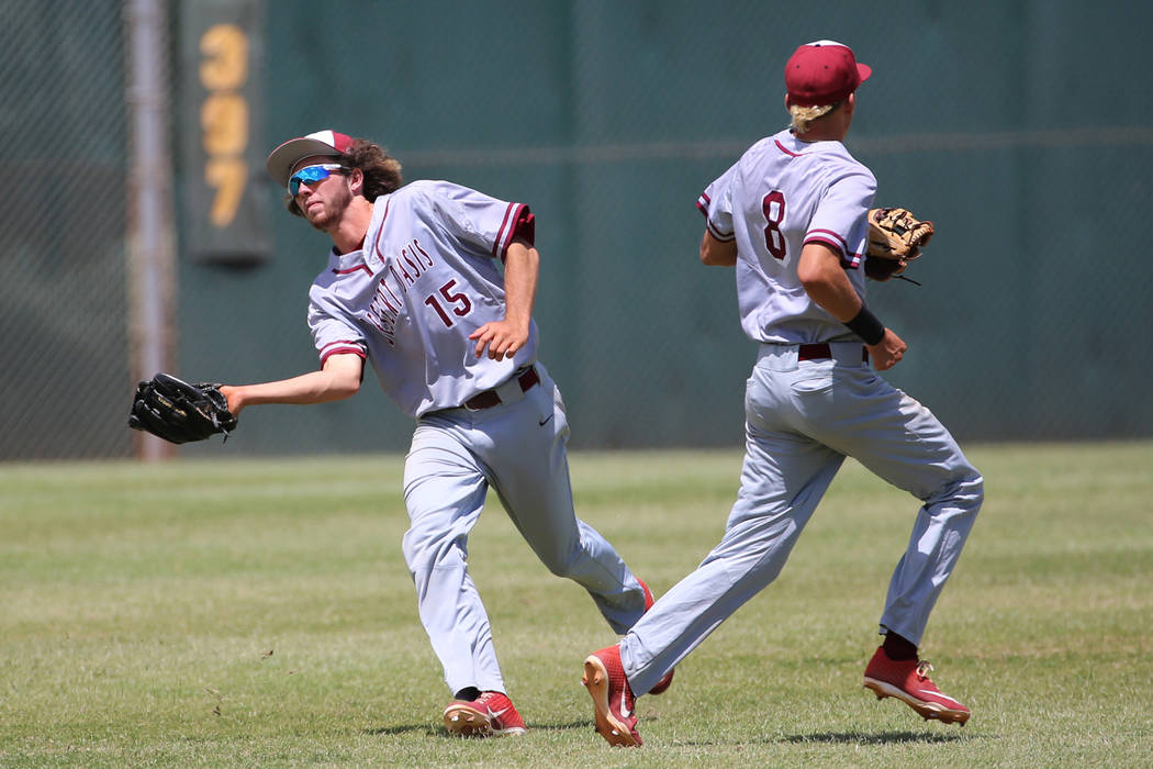 Desert Oasis' Campbell Holt (15) makes a catch in the outfield for an out against Las ...
