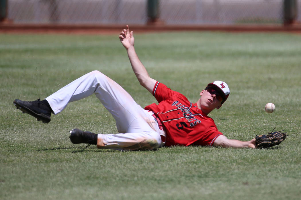 Las Vegas' Joel Lindahl (5) misses the ball in the outfield against Desert Oasis in th ...