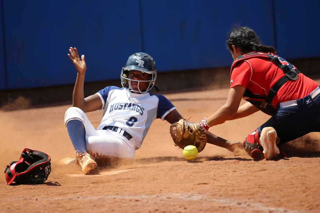 Shadow Ridge's Jasmine Martin (8) slides safe to home base for a run against Coronado& ...