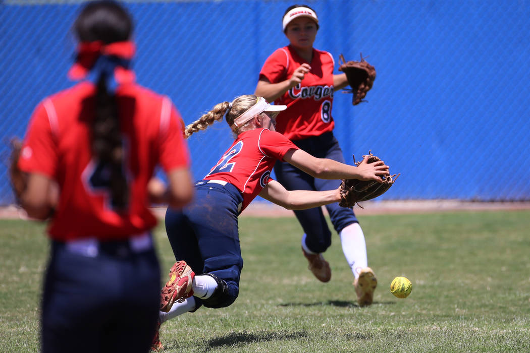 Coronado's Paige Sinicki (12) misses the ball in the outfield as her teammate Madison ...