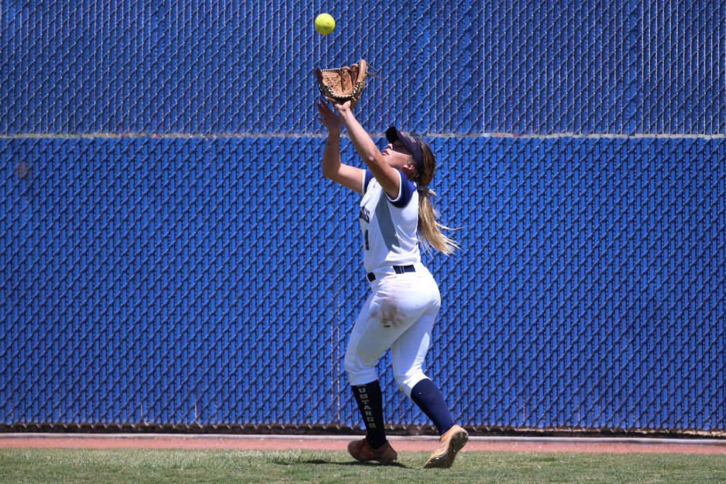 Shadow Ridge's Shea Clements (4) makes a catch in the outfield for an out against Coro ...