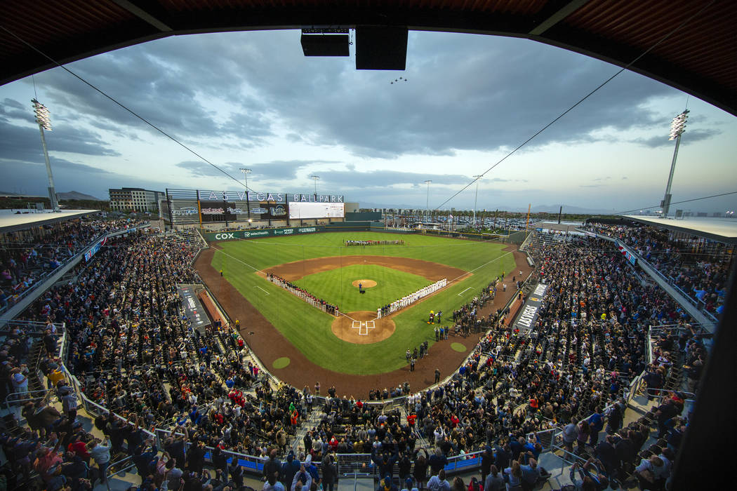Four F-16 jets from Nellis Air Force Base fly over the ballpark with an American flag unfurl ...