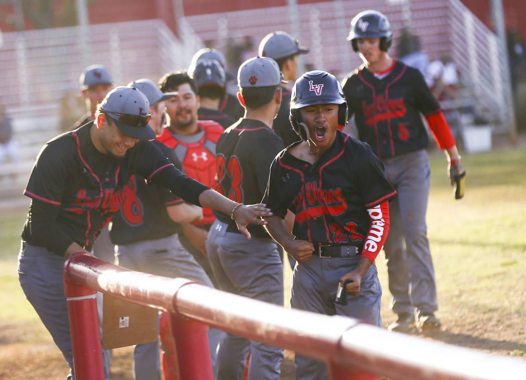 Las Vegas' Layne Adaro (22) celebrates his run against Arbor View during a baseball ga ...