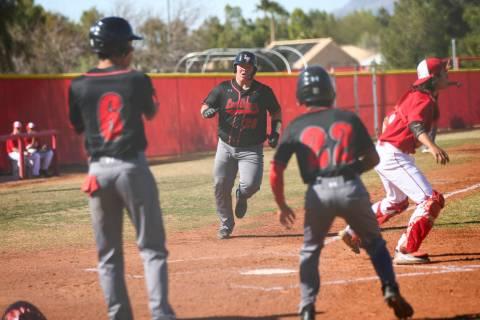 Las Vegas' first baseman Trevor Johnson (20) scores a run during a baseball game at Ar ...