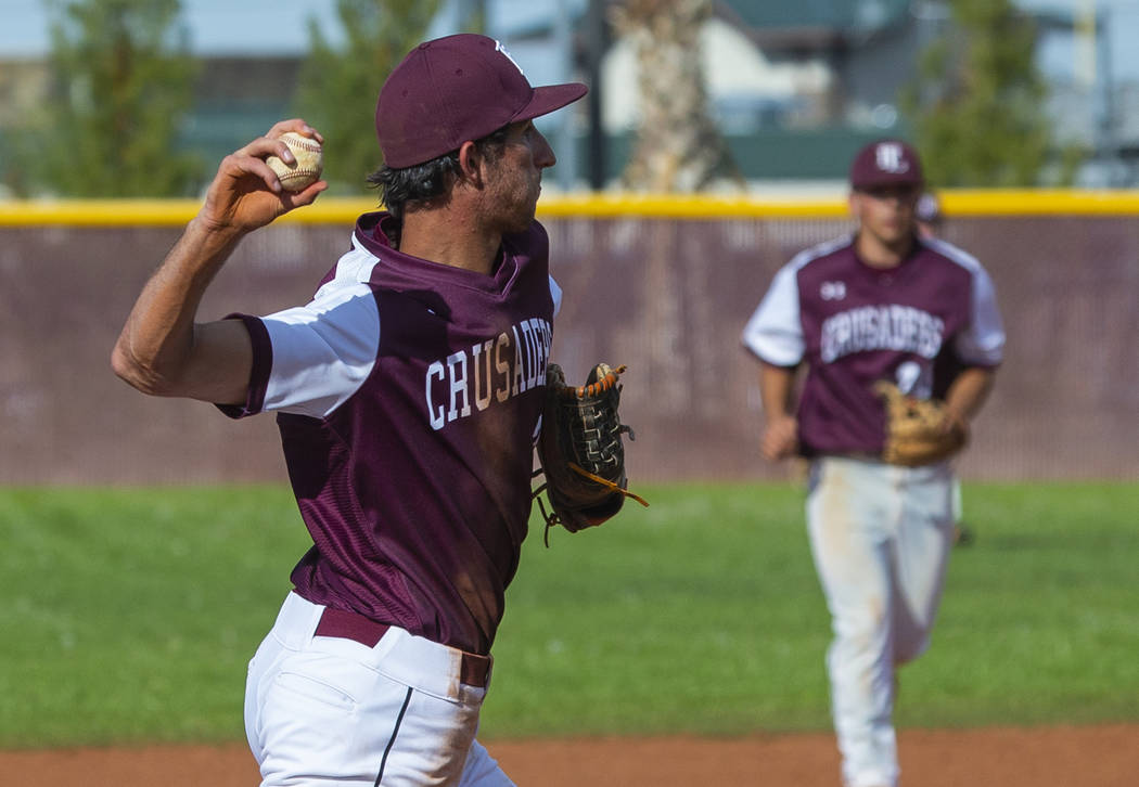 Faith Lutheran's Michael Rice (2) looks to first base on a throw versus Palo Verde dur ...