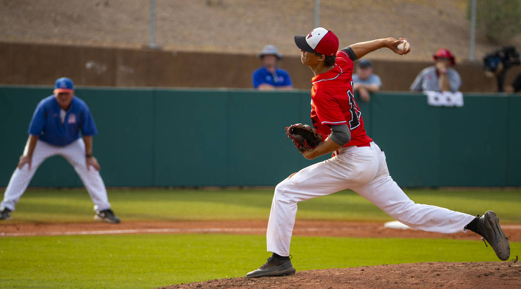Las Vegas pitcher Nathan Freimuth (12) winds up for a throw versus Reno during their state b ...