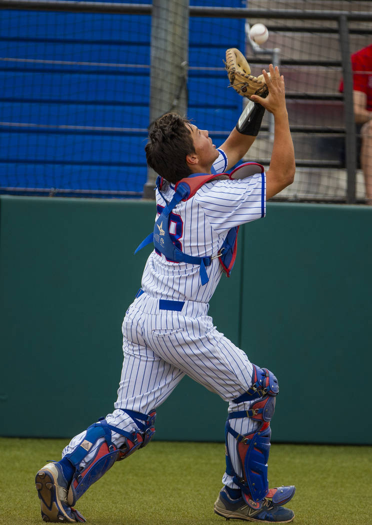 Reno catcher Lane Oliphant (28) pulls in an infield fly ball versus Las Vegas during their s ...