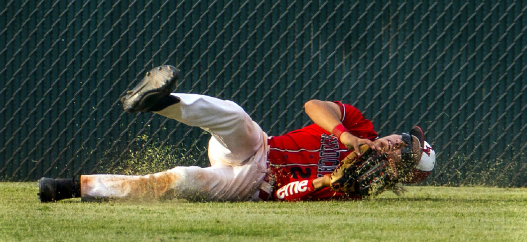 Las Vegas' Dalton Silet (23) secures a long, fly ball catch in the outfield after a ci ...