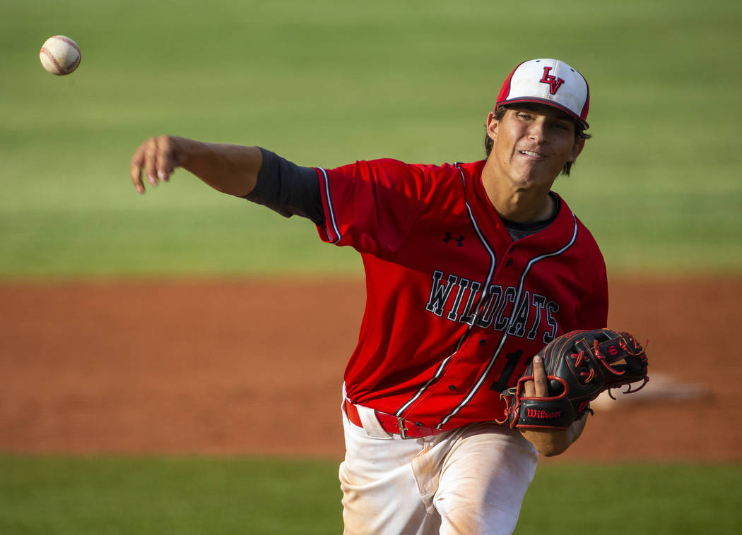 Las Vegas pitcher Nathan Freimuth (12) releases a throw versus Reno during their state baseb ...