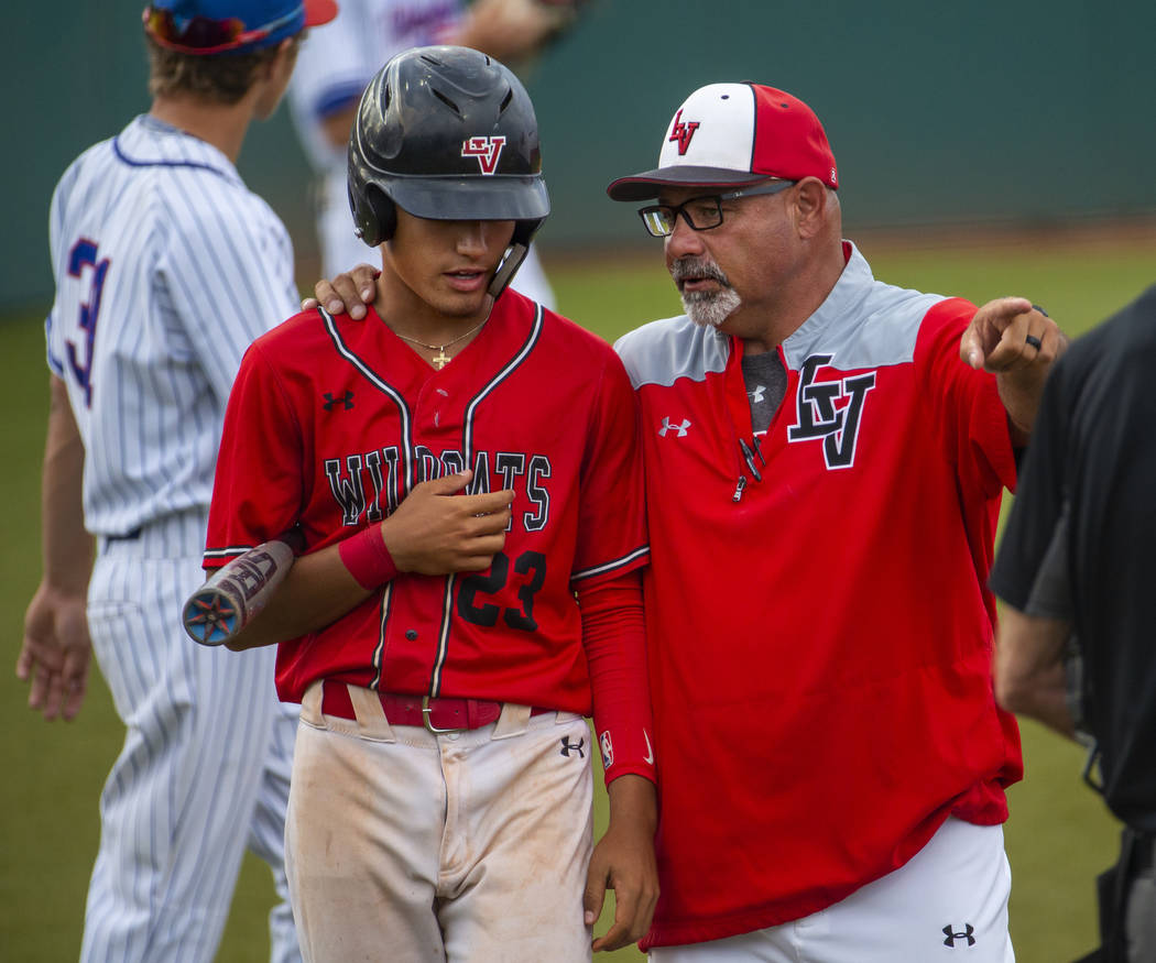 Las Vegas' Dalton Silet (23) is counseled by head coach Sam Thomas during a time out v ...