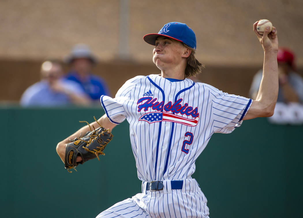 Reno pitcher John Barry (2) winds up for another throw versus Las Vegas during their state b ...