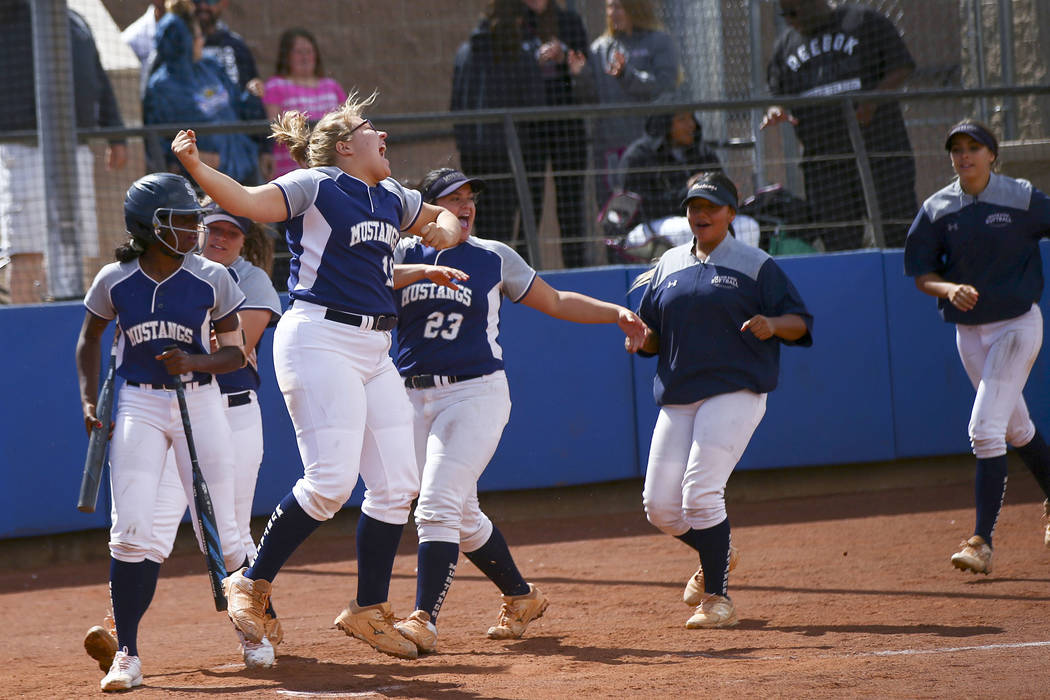 Shadow Ridge players celebrate a home run by Caitlin Covington, not pictured, during the sec ...