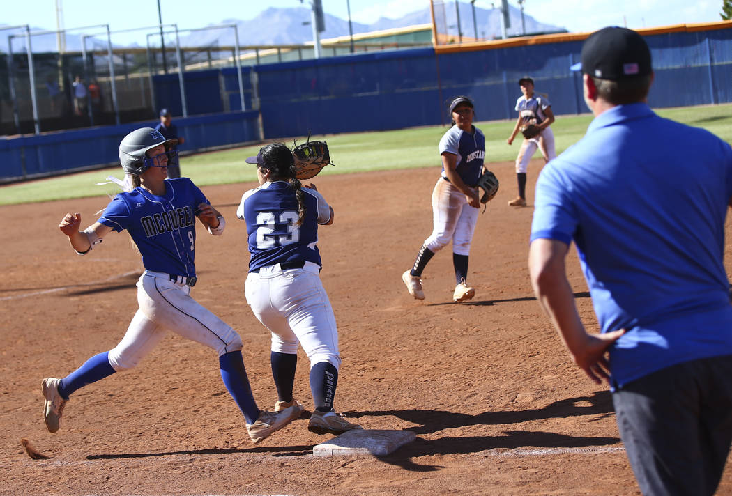 McQueen's Rylie Miller (9) gets tagged out by Shadow Ridge's Alexis Toia (23) du ...