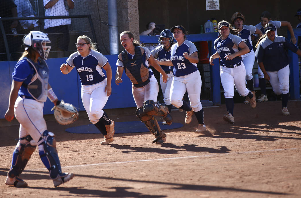 Shadow Ridge players celebrate a run by Alyssa Stanley, not pictured, during the second roun ...