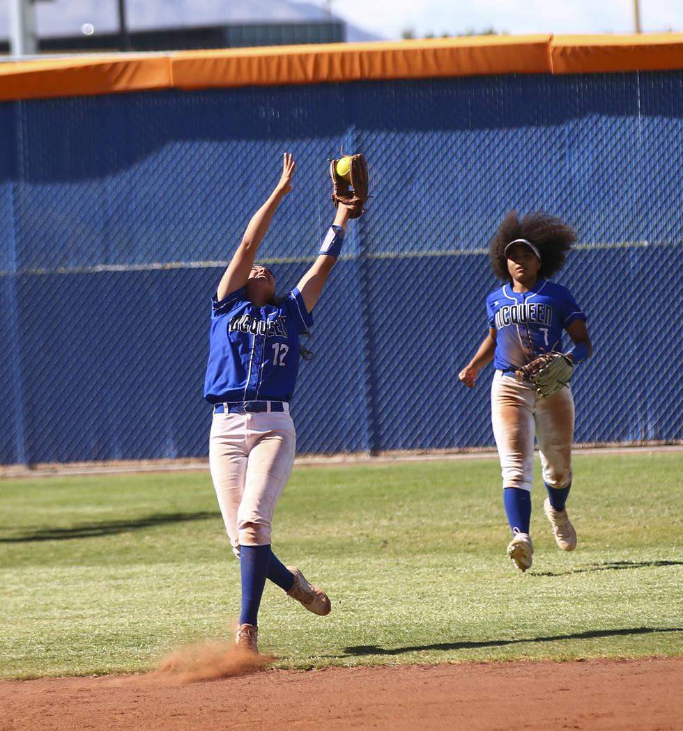 McQueen's Kiera Escalante (12) catches a fly ball from Shadow Ridge's Shea Cleme ...